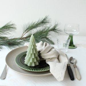 kerstboomkaars op bord